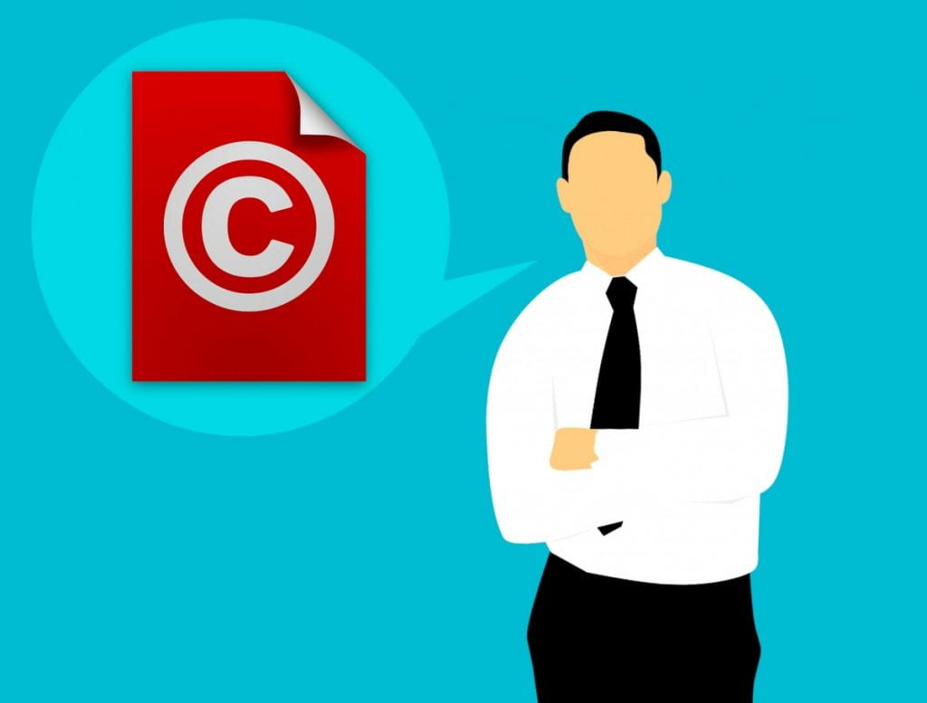 Cartoon image of a man with a speech bubble, containing a copyright icon